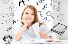 education and school concept — little student girl studying at school